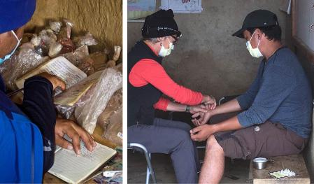 Volunteers working with Humli residents at the clinic.