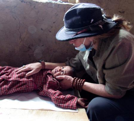 Humla Fund volunteer treating baby in clinic.
