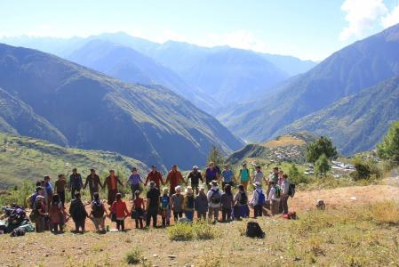 Humla Fund 2016 volunteers stand in a circle before mountains in Humla Region.